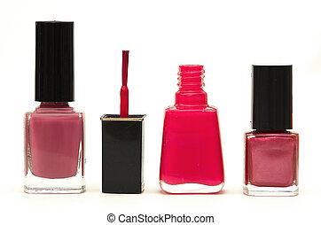 Nail Polish - Nail polish bottles against white.