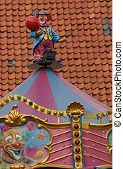 Clown figure at the top of a roundabout
