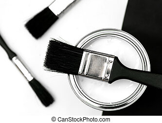 DIY - Paint brushes and white paint tin.