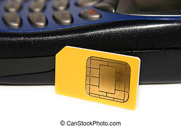 A SIM Card - A GSM SIM card smartcard and a GSM mobile phone...