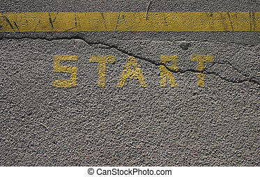 Start sign - Word start printed on an asphalt pavement,...