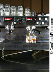 Espresso Shot - Two shots of espresso being drawn from a...