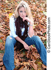 Amelia6 - Attractive young woman on fallen leaves