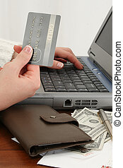 Online Shopping or Paying Bills - Womans hand with credit...