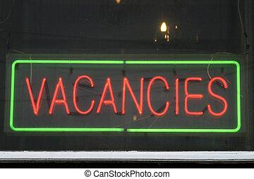 Vacancies - vacancy sign in a window
