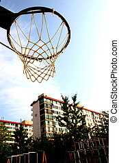 Basketball hoop with apartment buildings in the background