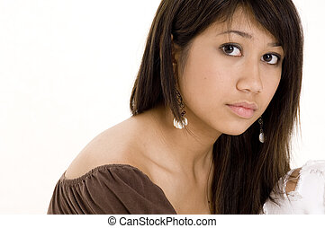 Pretty Teen 8 - A pretty young woman in a brown top on white...