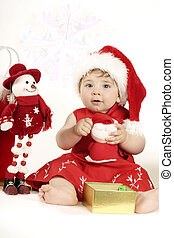 Christmas Play - 9mth baby in a red dress and santa hat...