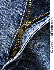 The zip in a pair of jeans - A pair of jeans with the zip...