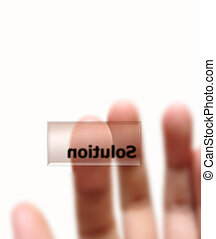 Solution - Finger almost touching the solution key,...