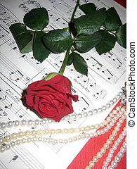 music and red rose - Opera sheet music, red rose and pearl...