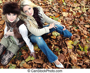 Keeley and Amelia - Two fashionModels on fallen leaves