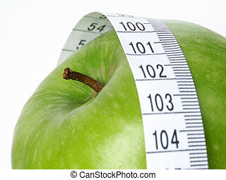 Green Apple with tape measure.