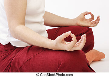 Cross legged - Lady sitting cross legged on meditation II