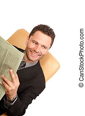 big news - happy handsome business man reading a newspaper -...