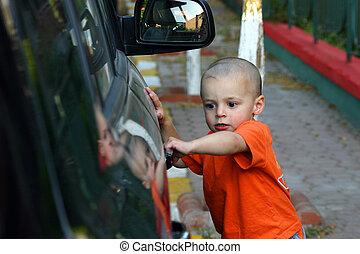 I\'m getting the Door - Little Boy Unlocking the Car Door