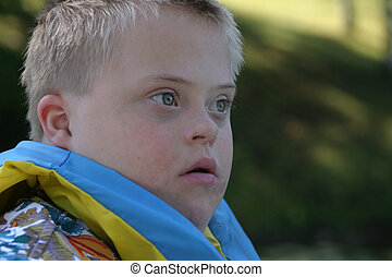 Down Syndrome Boy - Young boy with down syndrome wearing a...