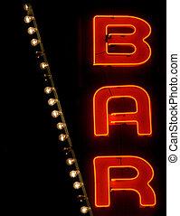 Bar Sign - A neon bar sign glows at night