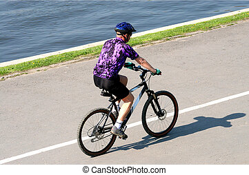 man on bicycle - adult man riding on mountain bicycle