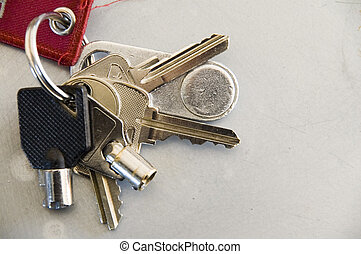 Bunch of keys - bunch of keys on key ring on grey surface