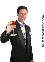 Champagne Toast Vertical - A handsome man in a tuxedo making...