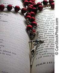 Rosary and a Bible - Focus on the crucifix