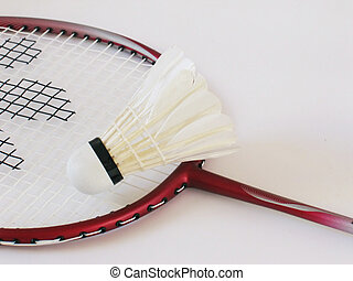 Badminton racket and shuttlecock. Focus is on the...