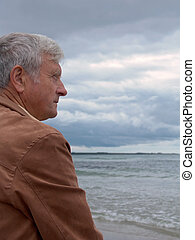 Man and Ocean - Elderly man overlooking the ocean