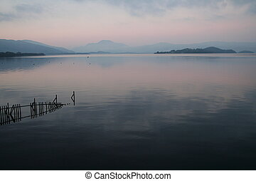 Loch Reflection - Late evening at Loch Lomond in Scotland