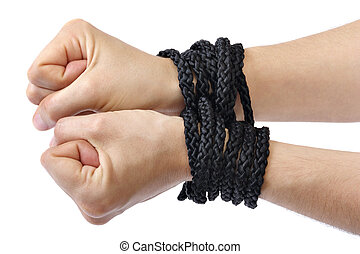 Hands tied - Ladys hands tied in black rope on white...