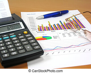 Sales Report 1 - Colorful sales charts, calculator, blue pen...