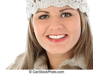 Beautiful Young Woman in Knit Hat and Fur Trimmed Coat. Shot...