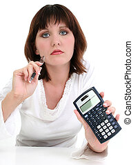 Beautiful Young Woman with Ink Pen and Calculator. Shot over...
