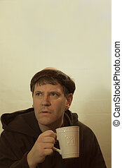 The Monk and His Coffee - Photo of a monk looking somewhat...