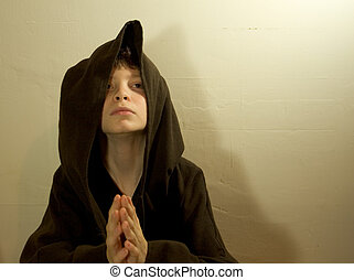 The Young Monk - Photo of a young monk lost in his devotions