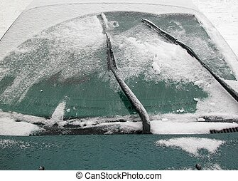 Winter windshield - Car windshield wipers attempting to move...
