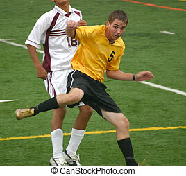 Soccer Players - Soccer player looks startled after kicking...