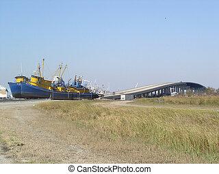 Post-Katrina - Menhaden boats stranded on the bridge in...