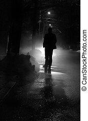 Nightwalk - Silhouette of a man in front of a bright light...