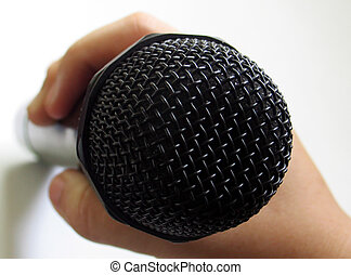 Holding microphone - Holding the microphone