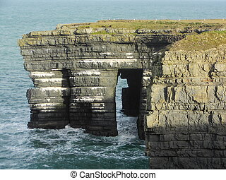sea arch - a sea arch at loop head county clare ireland