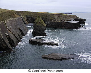 sea stack and cliffs at loop head county clare ireland