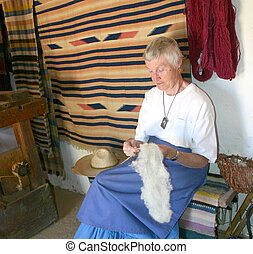 Spinster II - Elderly woman spinning wool with drop spindle