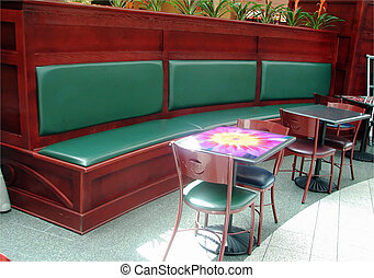 Food Court - Shot of some tables and chairs/booths in a food...