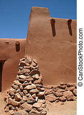 Adobe Hacienda - Detail of rock buttress at corner of...