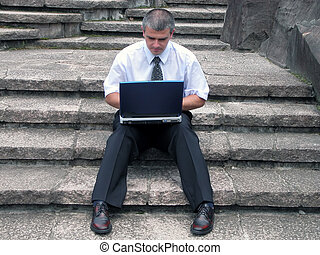 Businessman with laptop outdoor - Businessman working on the...