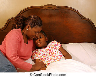 Comforting - A mother comforts her sick daughter.