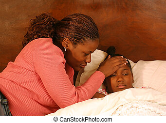 Fever - A mother feels her daughters head for a fever