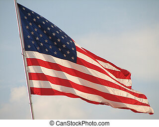American Flag - a Large american flag blowing in the wind.