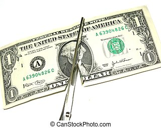 cutting costs - dollar bill being cut